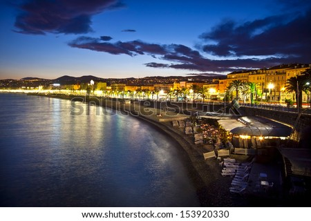 The beach and the waterfront of Nice at night, France. - stock photo