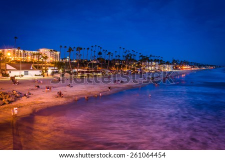 The beach at night, seen from the pier in Oceanside, California. - stock photo