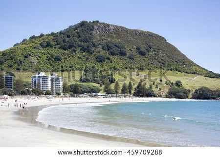 The beach in Mount Maunganui resort town with the same name mountain in a background (Tauranga, New Zealand).