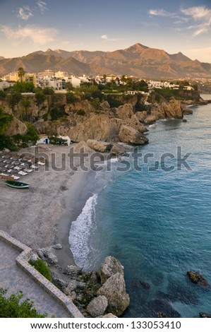 The beach in Nerja, Spain at sunset
