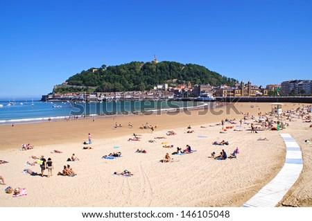 The beach in San Sebastian on a warm and sunny summer day - stock photo