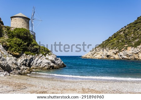 The beach of Lakes is a small rocky cove with some sand, found at north of the old town of Alonissos, known as Old Alonissos. - stock photo