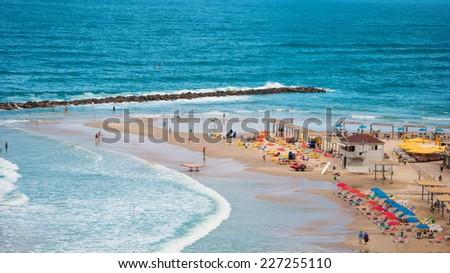 The beach on the Mediterranean Sea on the coast of Israel - stock photo