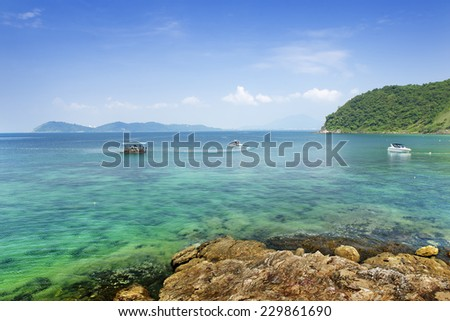 The beach under blue sky - stock photo