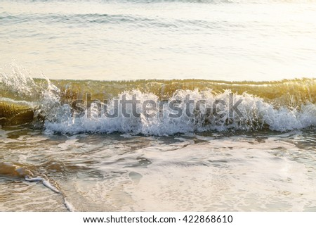 The beach with wave seaside during sunrise for background - stock photo