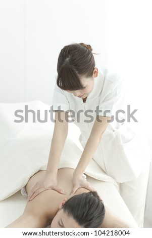 The beautician who massages the back - stock photo