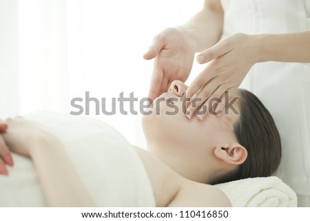 The beautician who massages the face - stock photo