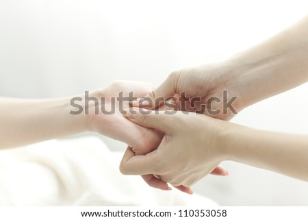 The beautician who massages the hand - stock photo