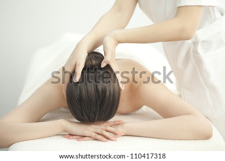 The beautician who massages the head - stock photo