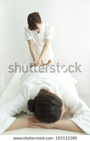The beautician who massages the leg - stock photo
