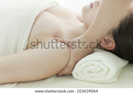 The beautician who massages the shoulder - stock photo