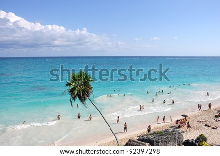 the beautiful and famous tulum beach above the ruins in mexico - stock photo