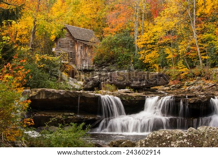 The beautiful and picturesque Glade Creek Grist Mill amidst the amazing colors of autumn at Babcock State Park in West Virginia. - stock photo
