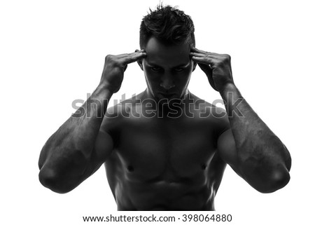 The beautiful and strong young guy holding head.Isolate.silhouette. headache.