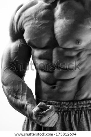 The beautiful and strong young muscular guy - stock photo