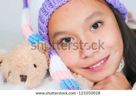 The beautiful Asian girl in a knitted sweater - stock photo