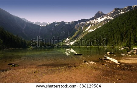 The beautiful Avalanche Lake at dawn, in Montana's Glacier National Park - stock photo