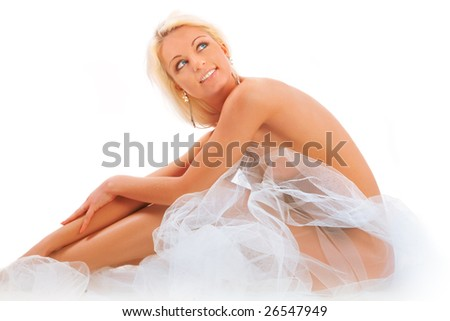 The beautiful blonde with a veil on a white background