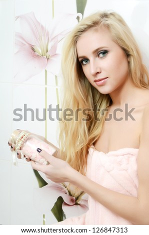 The beautiful blonde woman in a bathroom