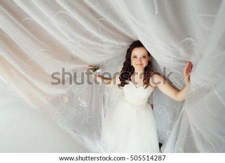 The beautiful bride on a white background