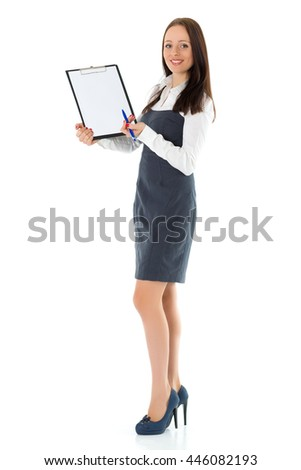 The beautiful businesswoman showing a blank clipboard stands on a white background.