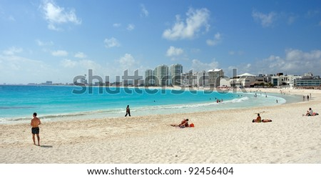 the beautiful cancún beach in mexico during a sunny day. photo by michelepautasso - stock photo