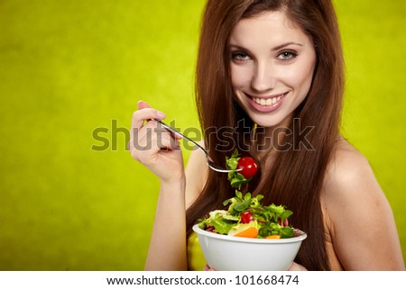 The beautiful cheerful young woman has breakfast salad
