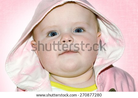 The beautiful child in a hood - stock photo