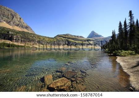 The beautiful clear clean water of Hidden Lake, Glacier National Park - stock photo