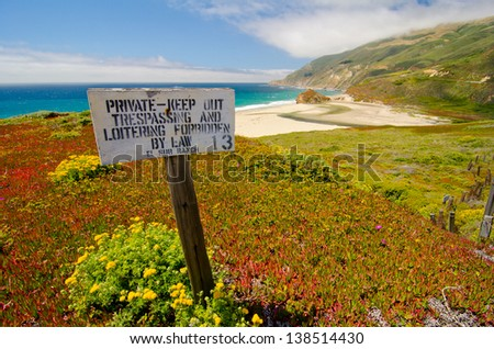The beautiful coastline alongside California State Route 1 can be seen, but not touched. - stock photo