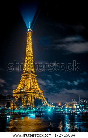 The beautiful Eiffel tower in Paris at night - stock photo