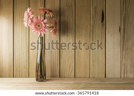 The beautiful flower on a wooden background - stock photo