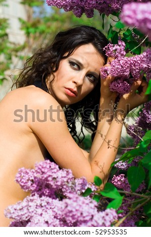 The beautiful girl and lilac bush