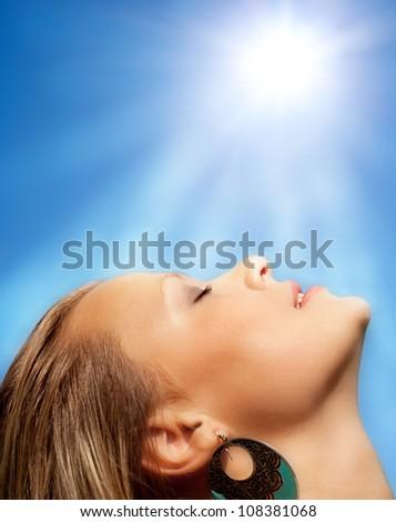 The beautiful girl and the sun. - stock photo