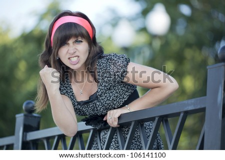 The beautiful girl becomes angry - stock photo