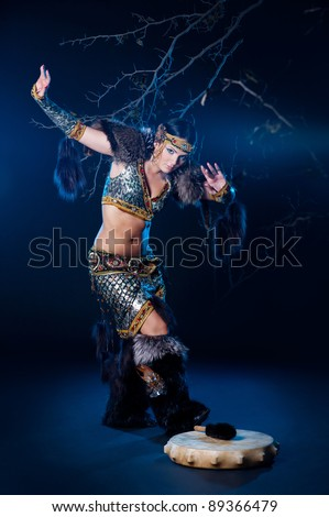 The beautiful girl  dancer in a suit of northern beauty or  shaman woman. - stock photo
