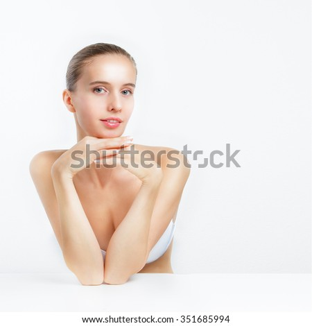 The beautiful girl holds hands at a chin - stock photo