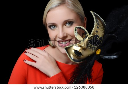 The beautiful girl in a carnival mask - stock photo