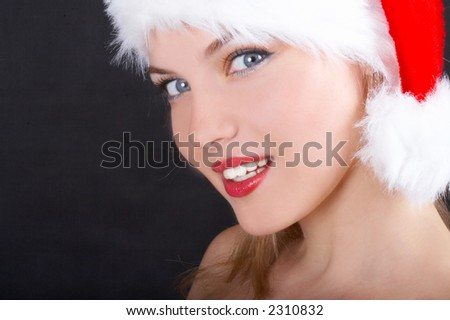 The beautiful girl in a christmas red cap