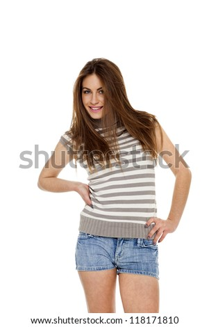 The beautiful girl in jeans shorts isolated - stock photo