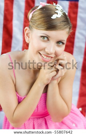 The beautiful girl in pinup style against the American flag