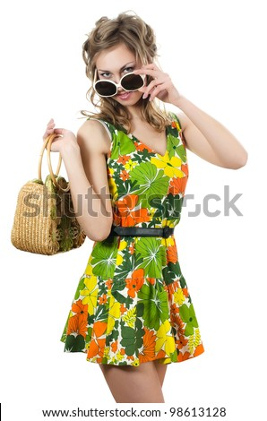 The beautiful girl in summer dress isolated - stock photo