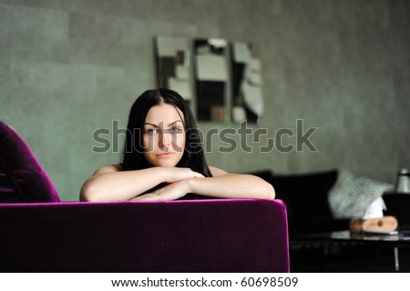 The beautiful girl lays on a sofa in a room - stock photo