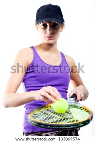 The beautiful girl learns to play tennis. - stock photo