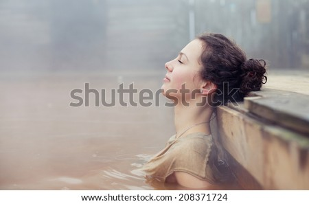 The beautiful girl lies in a medical source - stock photo