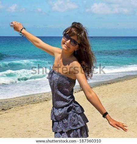 The beautiful girl on island Santorini. Greece  - stock photo