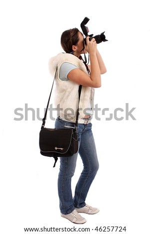 The beautiful girl photographer in front of the white background - stock photo