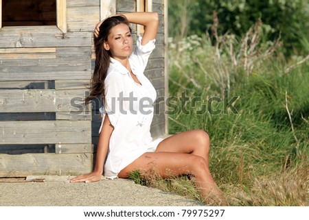 The beautiful girl relaxes on a sunset - stock photo