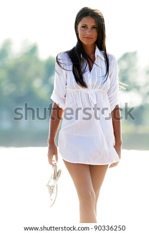 The beautiful girl relaxes on the beach - stock photo