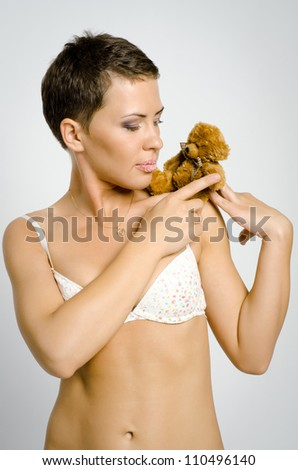 The beautiful girl with a bear cub